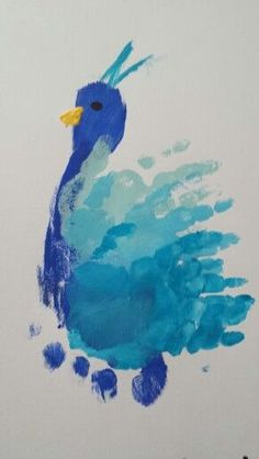 Make a peacock with a single footprint and then 3 handprints with 3 shades. Paint on the eye and beak.