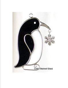 Stained Glass Penguin with snowflake charm sun catcher Stained Glass Patterns, Stained Glass Art, Stained Glass Suncatchers, Glass Artwork, Sun Catcher, Chrome Plating, Penguins, Wood Projects, Snowflakes
