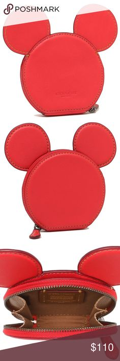 """NWT Disney X COACH Ltd Ed MICKEY MOUSE Coin Case BNWT Disney X COACH Limited Edition MICKEY MOUSE EARS Zip Coin Case. Smooth glovetanned leather small coin purse in the shape of Mickey Mouse's head. No longer available. Zip-around closure. Tan brown lined interior with tan brown leather Coach Disney patch. Gunmetal toned zipper. Embossed Coach name logo at back. The dimensions are approx.: 4"""" W x 3.75"""" H x 0.75"""" D (excluding 'ears')  Comes from pet free/smoke free environment. Check out my…"""