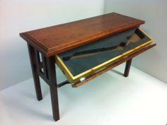 http://www.stashvault.com/wp-content/uploads/2014/01/concealed-gun-compartment-furniture-table.jpg