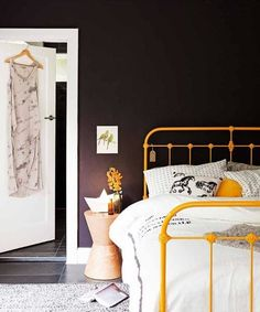 Extraordinary bedroom design idea with black walls, yellow bed and grey rug Cast Iron Bed Frame, Wrought Iron Bed Frames, Cast Iron Beds, Coral Walls Bedroom, Bedroom Black, Plum Walls, Black Bedrooms, Gothic Bedroom, Home Bedroom