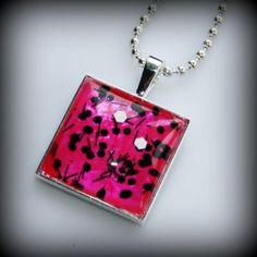 Hot pink with black and white confetti nail polish pendant.  Iron Butterfly Jewellery.   $18.00