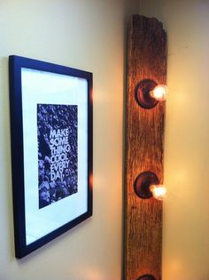 Those lights would look awesome in a bathroom above a mirror and sink. It should be a simple craft project.  Find a weathered plank of wood, maybe from an old barn, some lights. You can paint the base so that it looked more used.