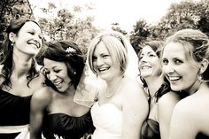Elizabeth and her bridesmaids enjoying the moment at a cotswold wedding at The Manor House Hotel in Moreton in Marsh