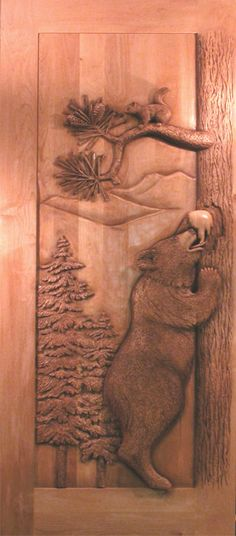 Carved Bear-Squirrel door by Ron Ramsey of Lake Tahoe.