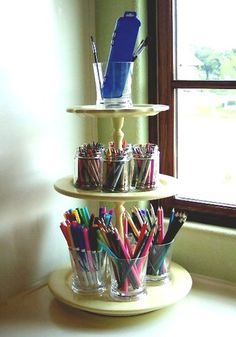 Use DIY cake stand on a lazy susan to hold art supplies - good idea helps reduce clutter on the desk