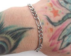 Browse unique items from TattooedAndChained on Etsy, a global marketplace of handmade, vintage and creative goods.