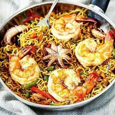 Thai stir fry over livefire with indomie noodles giant prawns and octopi flowers chilies and a garden of fresh vegetables. Just brilliant!  . Courtesy: The phenomenally talented @matsecooks . . . . . Blog: http://ift.tt/1vCV6pv  #thai #seafood #pescatarian #paleo #crab #shrimp #prawn #fish #ramen #noodles #muscles #octopus #calamari #pulpo #fried #instagood #foodstagram #foodgasm #foodporn #beer #bbq #barbecue #grill #grilling #asado #beautifulcuisines #asian #chef #firemakeseverythingbetter