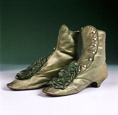 Boots, circa 1860, green satin, white side buttons, from the Old Sacramento Living History Program.