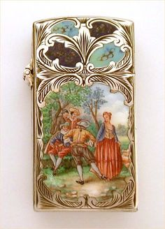 vintage 800 silver cigarette lighter with an enameled front panel featuring a lovely lady and her beau dancing together in the forest. Above the scene on the lid are enameled faux inlaid turquoise and lapis elements. Allover detailed hand engraving completes the design.  Italian