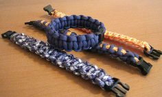 Paracord bracelets.  To make the middle one (with yellow accent), loop a length that is twice as long as the bracelet through and alternate tying knots over and under it.