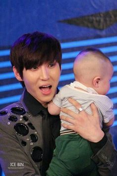 Leo is always so cute when he is holding a Lil kid! Man I just love him!~~~~~~Leo just killed my ovaries.......