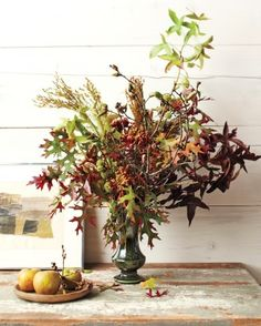 fall arrangement with oak and sweetgum branches
