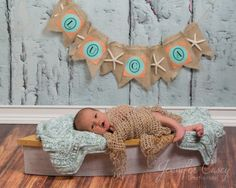 It's always fun to incorporate items with significant family meaning, like this hand made banner from the baby shower. www.jennifercaseyphotography.com