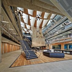 The atrium features a faceted wooden structure called the Suspended Studio - Melbourne School of Design, NADAAA and John Wardle Architects, Melbourne