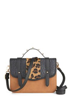 This bag is so perfect for Fall. It has a classic shape and a touch of edge. A bit of adventure, a lot of sassiness!