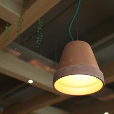 Clay pot used as pendent light in a new design for Singapore Burger King restaurants. Love this.
