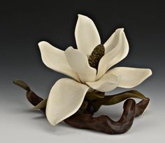 Flowers and leaves carved in wood. Nature wood carvings Denise Nielsen and George Worthington