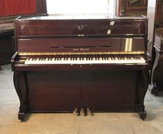 Karl Muller upright piano with a. mahogany case and cabriole legs from our affordable, starter piano range £600. Bid now!