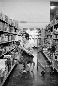 Audrey Hepburn with Ip in the supermarket, 1958. I think fawns might be my new favourite animal.