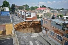 """Around June 7th 2010, a strange hole appeared in the middle of Guatemala City, Mexico. Many said it was a sink hole but the hole is almost a perfect circle almost like it was drilled in to the ground. First thought in my mind when I saw the photos, """"War of the Worlds""""."""
