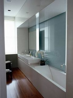 long vanity, wall cladding, shiny , wood, clever cupboards