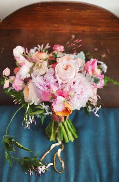 Beautiful pink and mauve bouquet of sweet peas and ranunculus and sage!
