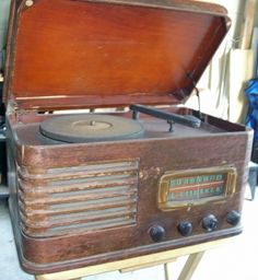 @Rachel Landrum - This Pre-1930 Record Player looks like what they may have been modeling Mama & Daddy's replica after.