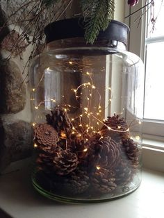tiny lights and pinecones in a jar make a cool fall deocration