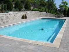 rectangular pool with sloping uphill retaining wall ... on Uphill Backyard Landscaping Ideas id=93472