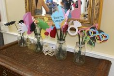 The props were cut using a Silhouette Cameo (and some creative tracing of designs). They were hot-glued onto bamboo skewers that you can find in the floral section of the craft store. Separate them into 4 jars: moustaches, wearable props, accessories, and eye-glasses. Beautiful Pink Bridal Shower - DoyleDispatch.com #doylepartyoftwo