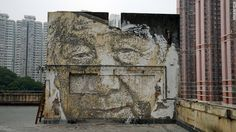 """Ephemeral urban art by raucous street artist Alexandre Farto, who goes by the tag """"Vhils,"""" Timed to coincide with Art Basel Hong Kong 2016, """"Debris"""" explores Vhils' love-hate relationship with Hong Kong's metropolis. It's a place he's called home since last August, after the Hong Kong Contemporary Art (HOCA) Foundation invited him to do an artist residency. This portrait is based on a photograph of a Hong Kong factory worker at a former cotton mill in the industrial neighborhood of Tsuen…"""