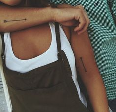 Couples tattoo. I love arrow tattoos. Something I would want to get.