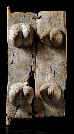Africa | Granary door from the Dogon people of Mali | Wood and metal | Consisting of two wooden planks, each carved with two pairs of massive female breasts