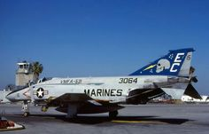 A USMC McDonnell F-4J Phantom II from VFMA-531 sits on the ramp.
