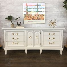 * Solid wood dresser would also function well as a TV console, buffet, or changing table * Professionally sprayed in a white lacquer for a smooth and even finish * Original brass hardware * Six functioning dovetailed drawers glide smoothly on center tracks * One door opens up to three interior drawers Dimensions: 72 length x 19 depth x 32.5 height