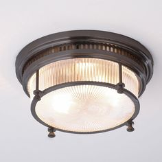 wide x Prismatic fresnel glass is encased in Bronze finished steel. The industrial fittings and metal grill rim give this ceiling light an industrial edge. Lamp with LED equiv. Porch Ceiling Lights, Semi Flush Ceiling Lights, Flush Mount Ceiling, Flush Mount Lighting, Vintage Bathroom Lighting, Bathroom Ceiling Light, Bathroom Light Fixtures, Ceiling Light Fixtures, Bathroom Vintage