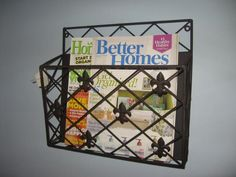 This magazine, mail or office file organizer mounts to the wall, clearing your countertops and desk from clutter.  Hang multiples for maximum storage capacity.  So versatile it can be used in a kitchen, mudroom or bathroom and a home office or study.  Sturdy wrought iron with a black powder coat finish and fleur-de-lis accents.