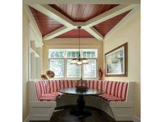 Kitchen: booth, ceiling, colour scheme (red, cream, dark chocolate)