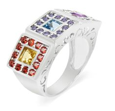 This is a bold new design presented by LenYa and it carries a distinct flavor of colorfulness and simple charm to it. This ring has a complement of Amethyst, Light Swiss Blue Topaz, Citrine, Rhodolite, Iolite and Red Sapphires which are arranged in a square manner in three blocks along the front display area of the ring. The ring itself is made out of 925 Sterling Silver and is coated with a layer of Rhodium which enhances its appearance.