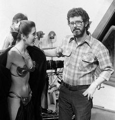 A less-young George Lucas getting creepy with Carrie Fisher.