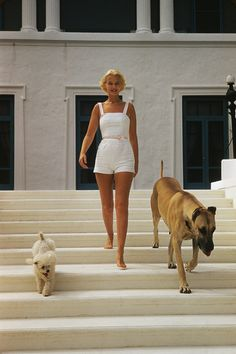 American socialite Mrs. Winston F. C. Guest (aka C. Z. Guest, 1920 - 2003) with a poodle and a Great Dane at her ocean-front estate, Villa Artemis, in Palm Beach, Florida, circa 1955. (Photo by Slim Aarons/Hulton Archive/Getty Images)