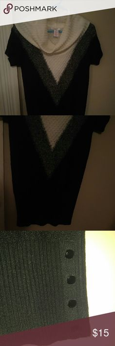 NWOT Candie's Turtle Neck Sweater Dress Sz S NWOT Candie's black, white, and grey turtle neck sweater dress. It has 4 square buttons on the bottom of each side. Never worn. Candie's Sweaters Cowl & Turtlenecks