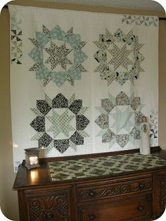 Love the pinwheels in the border - QuiltNut Creations