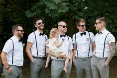 Groomsmen wear short sleeve shirts, braces & bow ties -   Image by Ali Lovegrove Photography - A wedding at Halstead House with a pink and grey colour scheme and the groom wearing Ted Baker with photography by Ali Lovegrove Photography