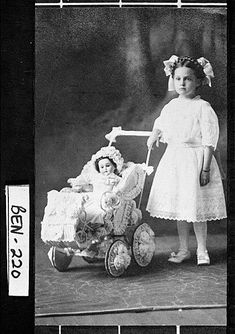 Photograph of Catherine Clark with her doll and carriage, Fitzgerald, Ben Hill County, Georgia, ca. 1911.