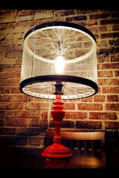 Bicycle part lamp--use a bicycle wheel as the frame for the oyster shell chandelier.