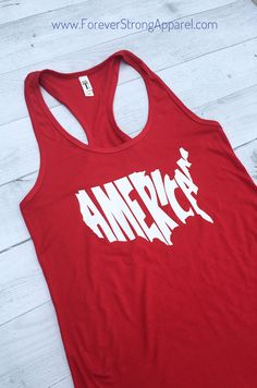 Proud to be an American? Show off your pride with this Fourth of July shirt. Cute, comfy and patriotic. Shirt Specs: *Fabric laundered to reduce shrinkage oz combed ringspun cotton/polyester *available in 2 design colors Fourth Of July Shirts, 4th Of July, Running Tanks, Usa Shirt, Vinyl Shirts, Red White Blue, Summer Time, Athletic Tank Tops, Shirt Ideas