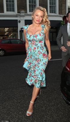 Turning heads! The stunning actress, 49, stepped out in a Spring-inspired ensemble, making...