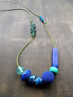Apple green leather with a mix of beads and crochet details for this long summerfun necklace